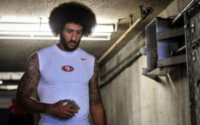 Kaepernick to stand during national anthem: report