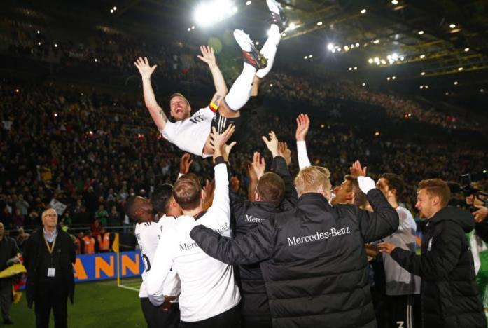 Soccer: Germany's Podolski crowns farewell with stunning winner over England