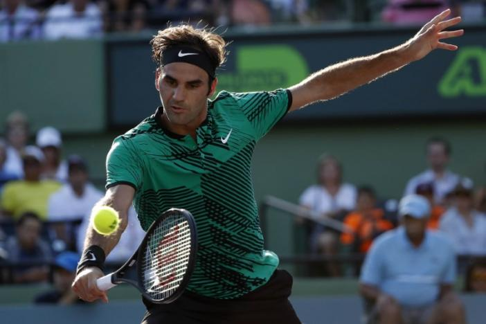 Federer in, Wawrinka out on mixed day for Swiss