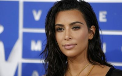 TV's Kardashian says she's 'much better' person after Paris robbery