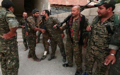 U.S.-allied Kurd militia says struck Syria base deal with Russia