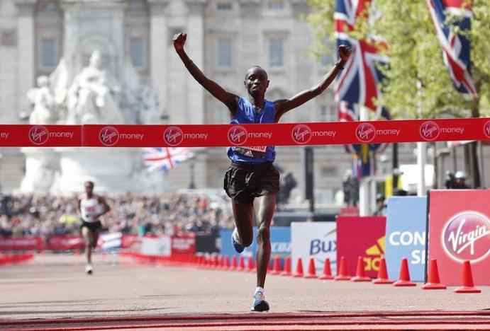 Wanjiru holds of Bekele in London