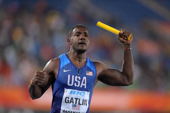 Gatlin, U.S. romp to victory on night of miscues