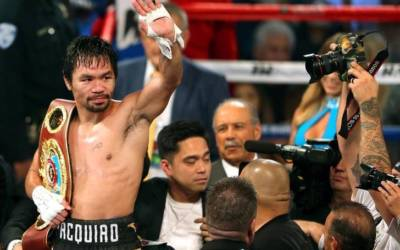 Pacquiao lands Down Under, tells Horn to be ready