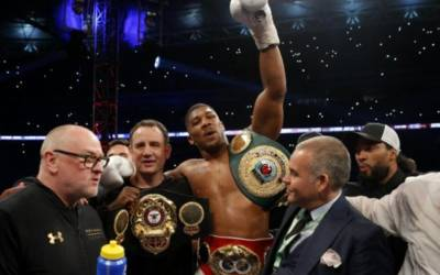 Joshua wins world titles with 11th-round stoppage of Klitschko