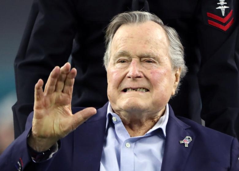 Former U.S. President George H.W. Bush to remain in hospital