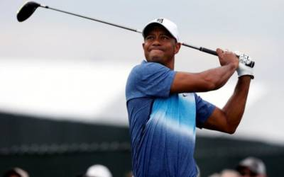 Woods hits first public shots in months, no date for return