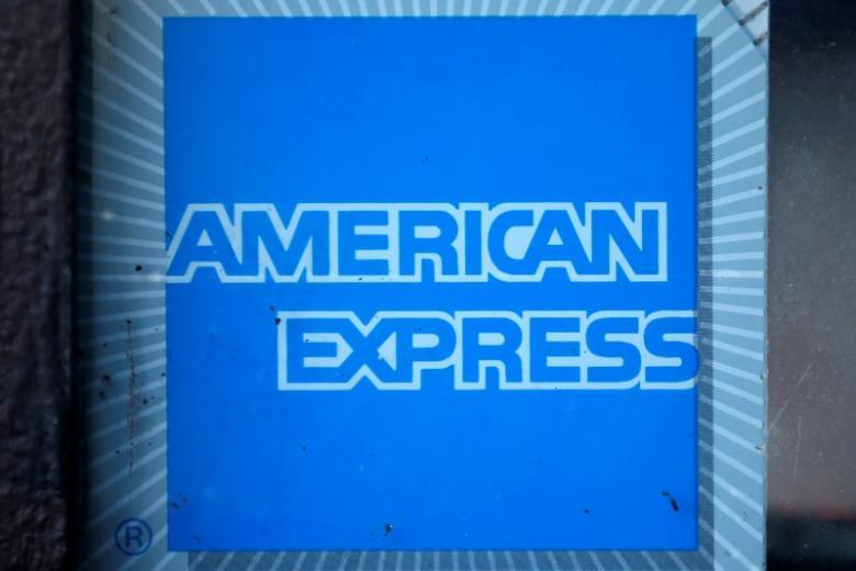 AmEx profit tops estimates as card members spend more