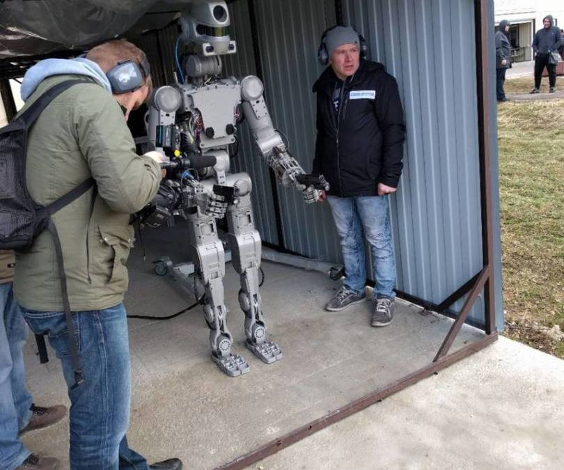 Humanoid Robot Learns to Shoot Using Both Arms