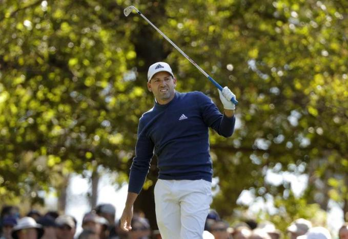 Garcia grabs share of Masters lead, Couples three back