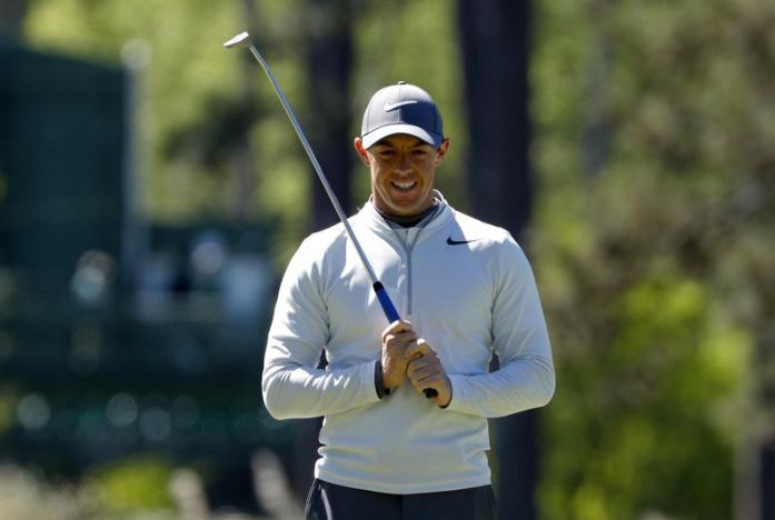 Golf: McIlroy rues cruel ricochet that leaves him five back