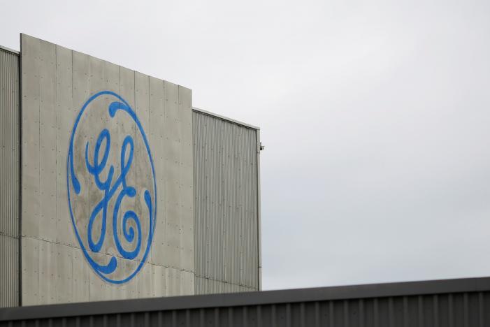 GE cash flow turns negative in quarter; profit, revenue beat