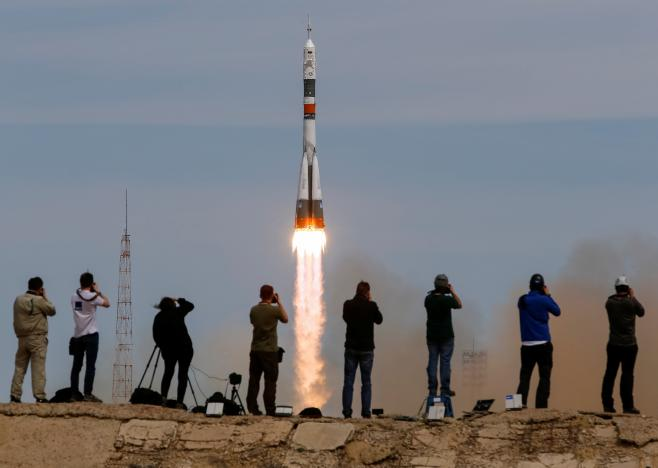 U.S.-Russian crew blasts off for space station with one empty seat