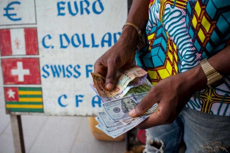 A decade after debt forgiveness, Africa still hooked on dollars