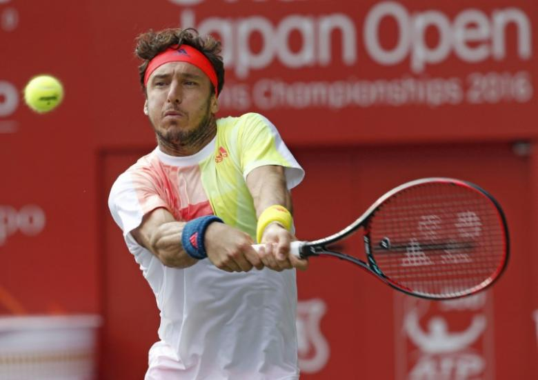 Former world number 10 Monaco hangs up his racket