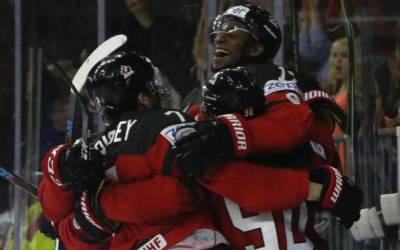 Holders Canada stun Russia with third-period comeback