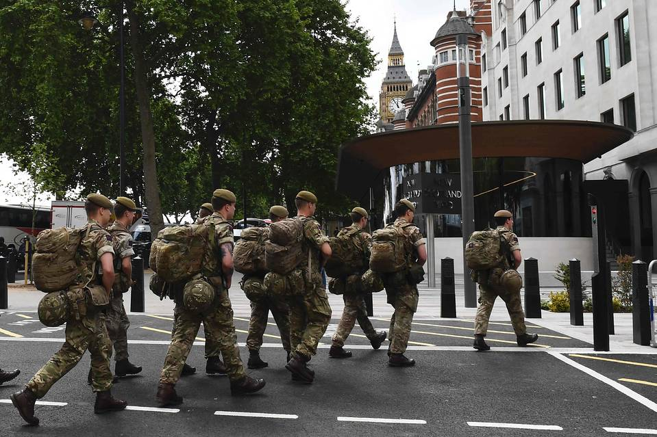 Army sends 1,000 heavily-armed soldiers to guard Buckingham Palace and key UK locations as PM warns ANOTHER terror attack is 'imminent'
