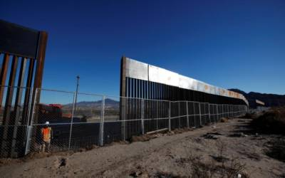Amid opposition, Trump makes low budget request for Mexico border wall