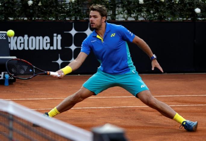 Wawrinka falls in Rome, Djokovic into quarter-finals
