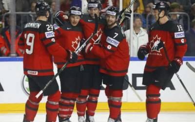 Ice hockey: Holders Canada set up world semi-final against Russia