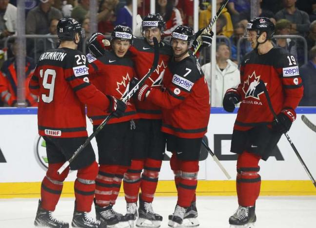 Ice hockey: Holders Canada set up world semi-final against Russia