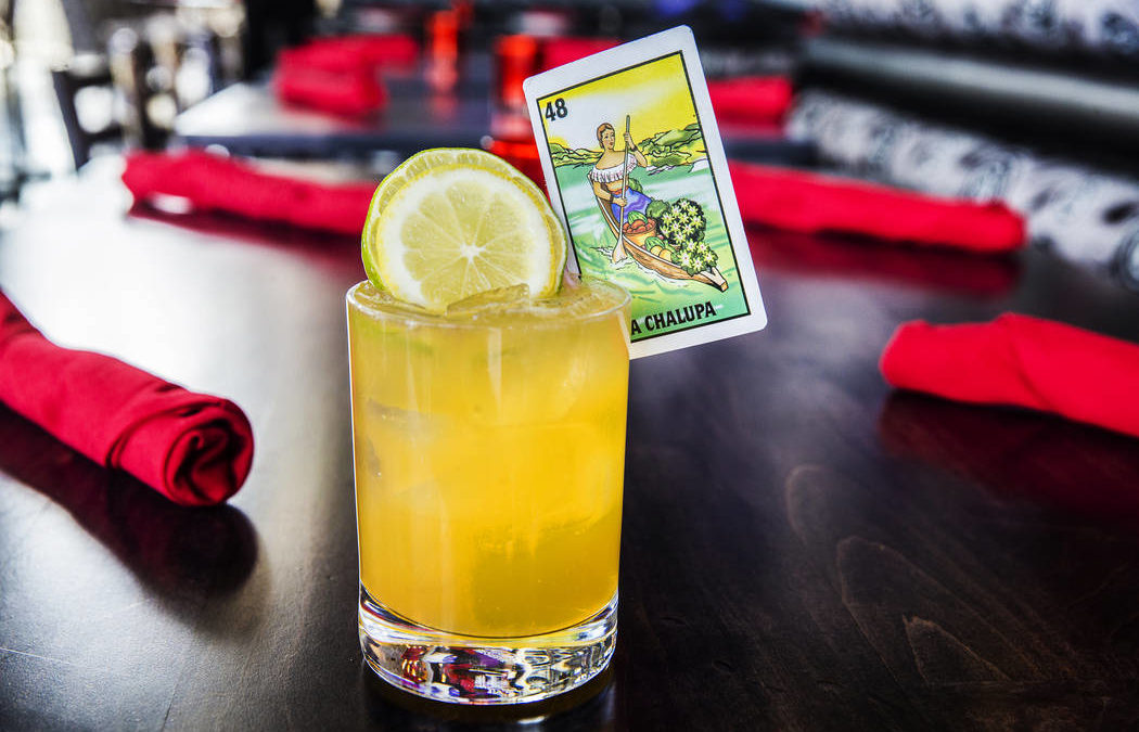 Summertime cocktail El Cazo served with playing card