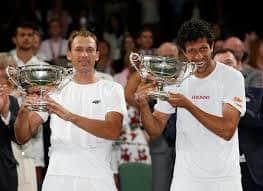Marathon men Kubot and Melo win Wimbledon doubles crown