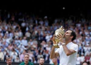 Wimbledon trophy is instant hangover cure for Federer