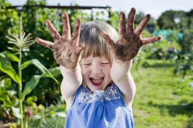 Children need to be allowed to play in the dirt to fully develop their immune systems, expert claims