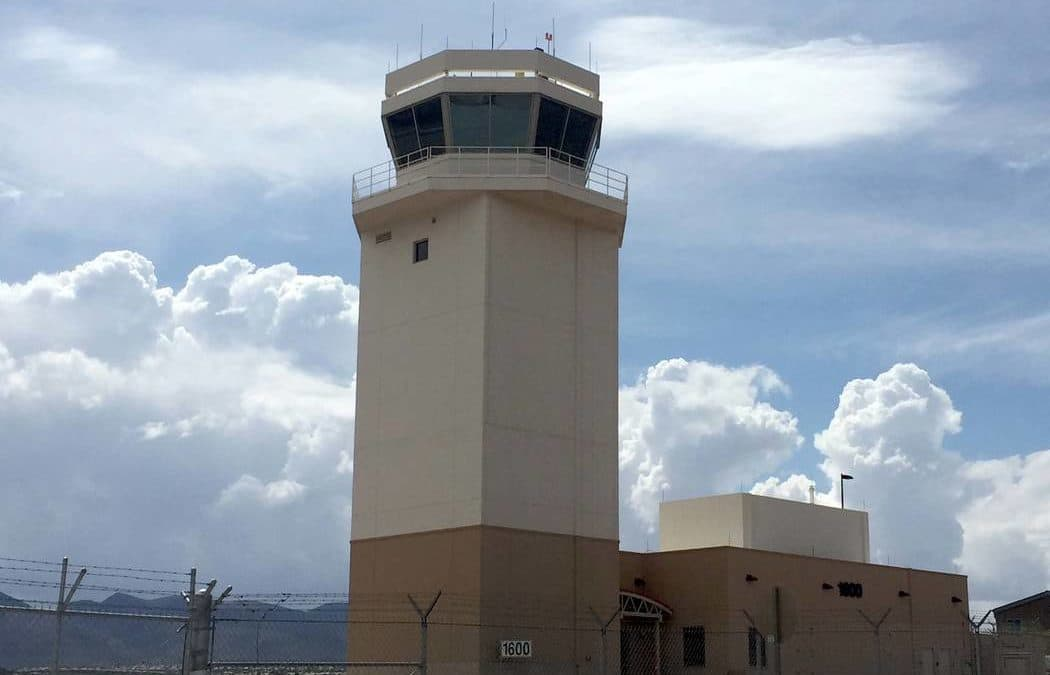 Plane rolls through fence at Henderson airport