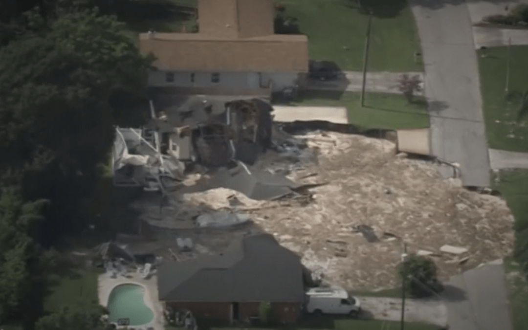 Florida sinkhole swallows two homes, threatens others