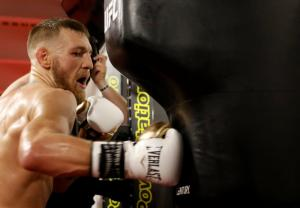Lighter gloves spell quick end of Mayweather, says McGregor