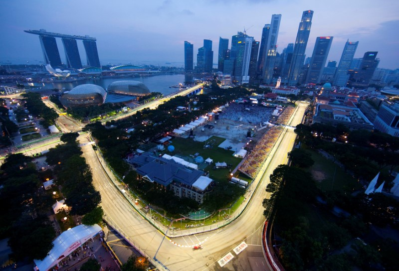 Motor racing-No deal yet but F1 plans long-term stay in Singapore: Carey