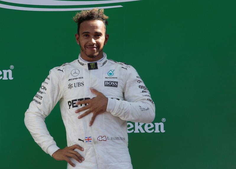 Hamilton chasing Singapore hat-trick but wary of Ferrari