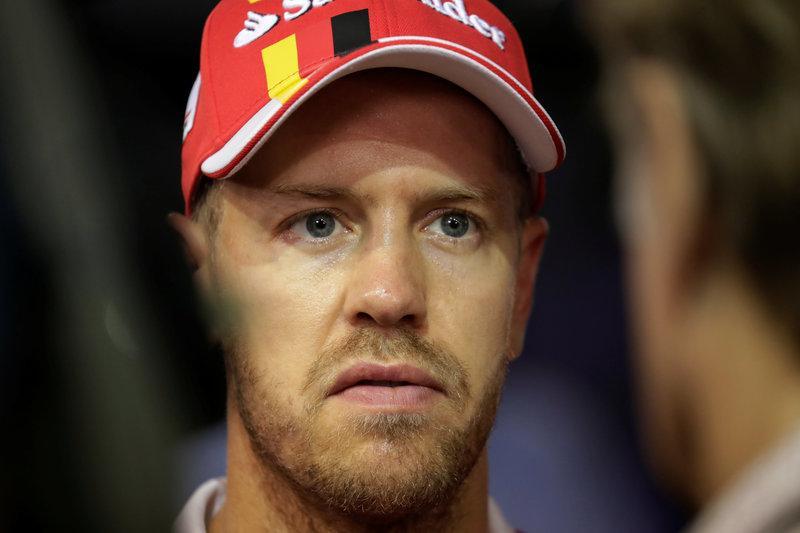 Vettel's hopes of regaining title lead wrecked in Singapore GP crash