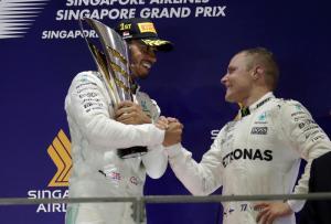 Motor racing: Hamilton takes big step toward fourth title
