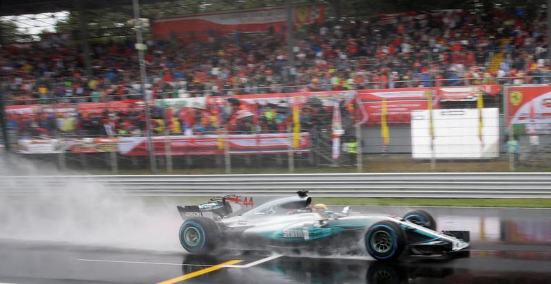 Motor racing: Rainmaster Hamilton takes record pole at Monza