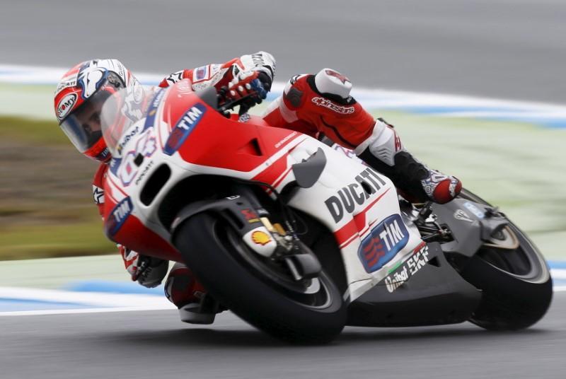 Motorcycling: Dovizioso victory keeps title race alive
