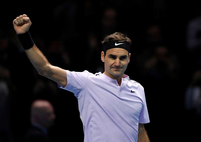 Federer opens ATP Finals bid with victory over Sock