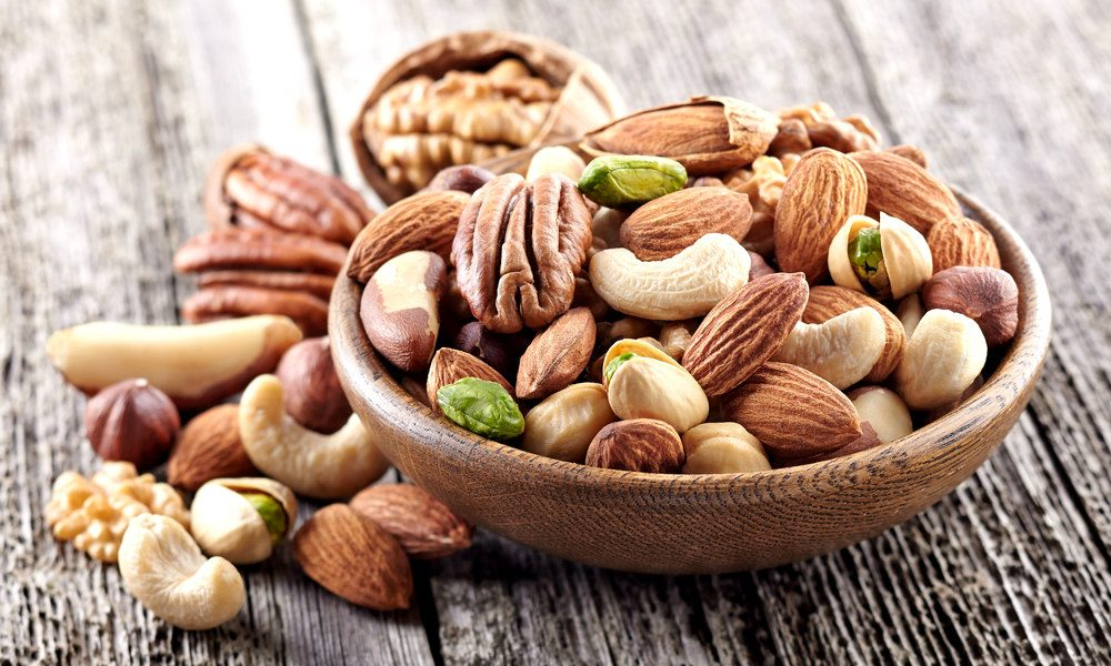 Lower your risk for heart disease when you make peanuts and tree nuts a regular part of your diet