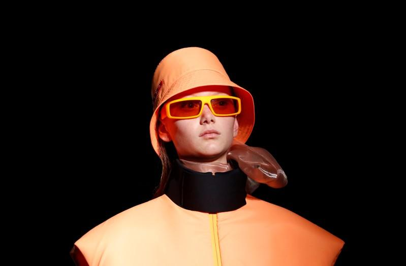 Prada brings Milan to its feet, with a collection of bold lines and colors