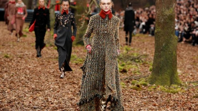 Models take a walk through wintry woods for Chanel