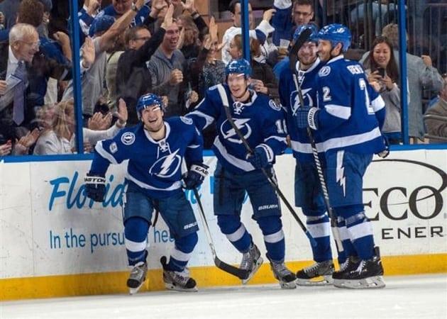 Lightning beat Devils to reach second round