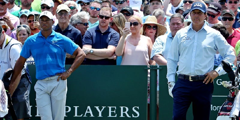 Tiger scratches out 72, Mickelson implodes in 'super group'