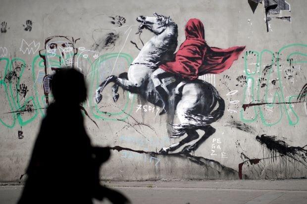 Banksy's subversive art draws tourists and locals in Paris