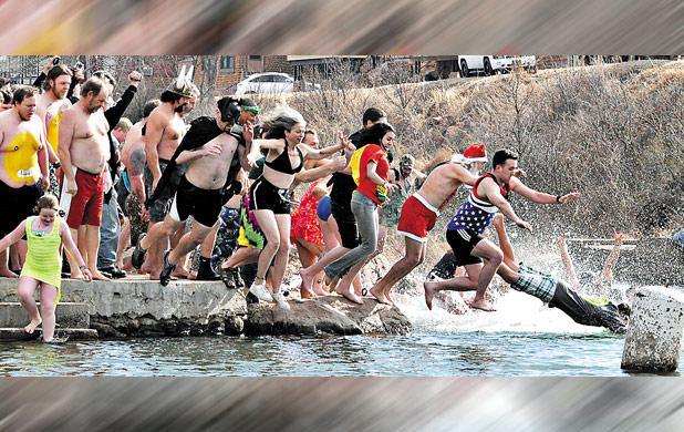 Oklahomans jump in freezing water during Medicine Park Polar Plunge