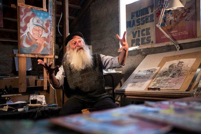 From Batman to Holy Land, comics artist sees heroes on all sides