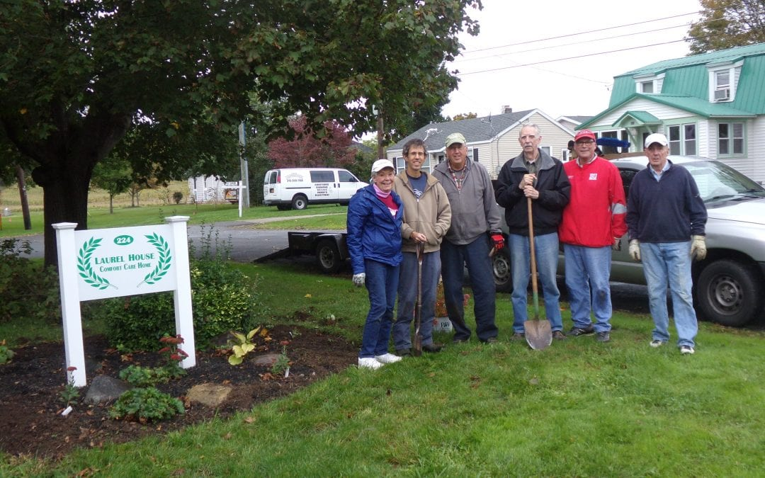 Volunteers working at Fall Cleanup at Laurel House Comfort Care Home