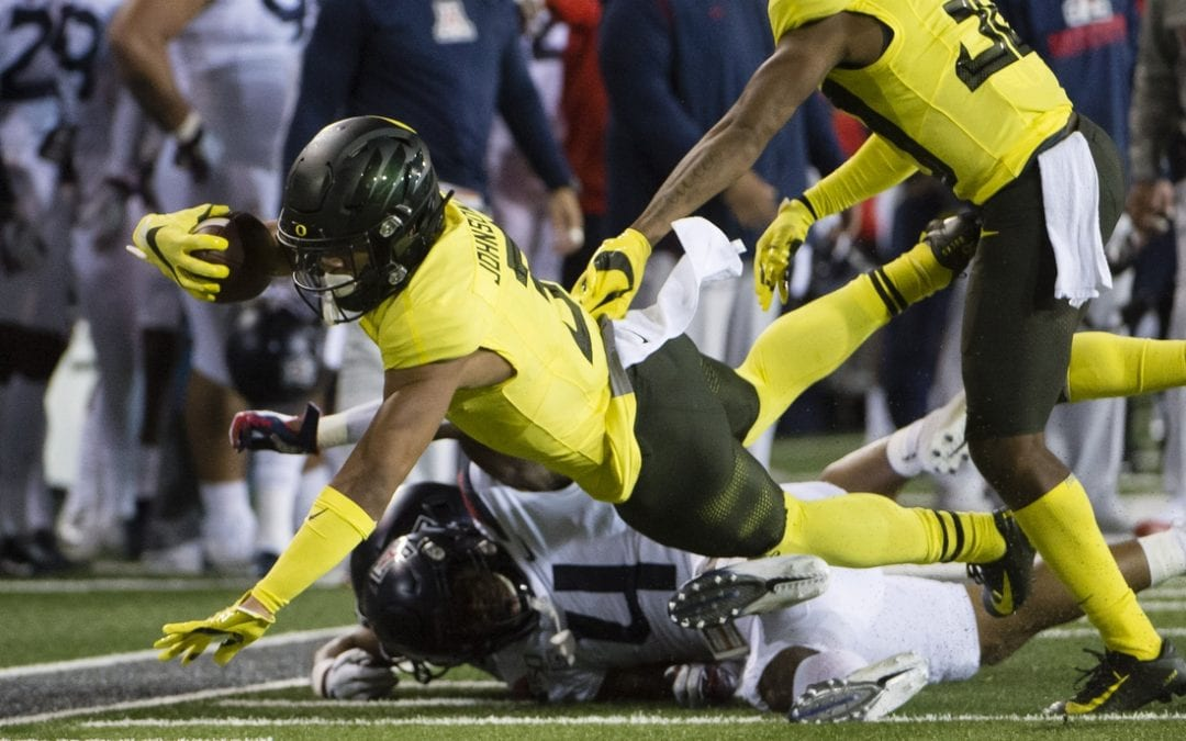 No. 6 Oregon beats Arizona to clinch Pac-12 North