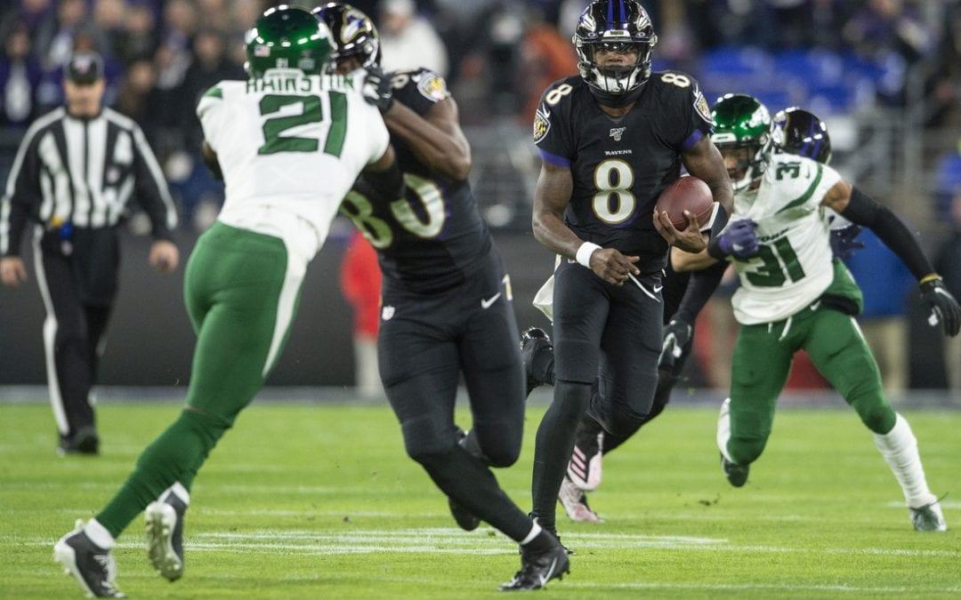 Jackson breaks QB rushing record as Ravens rout Jets